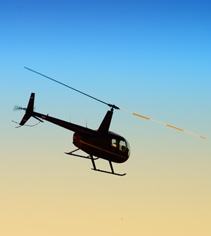 helicopter flying against the evening sky
