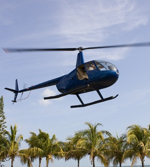 Robinson R44 taking off